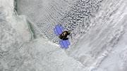 Top view of Earth-observing ICESat spacecraft in orbit above The Canadian Arctic. Data: NASA/JPL.