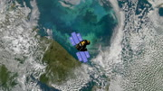 Top view of Earth-observing ICESat spacecraft in orbit above The Barents Sea. Data: NASA/JPL.