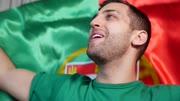 Portuguese Guy Celebrating in Flag - in Slow Motion
