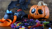 Halloween Trick or Treat with pumpkin jack o lantern and candy, with falling candy.