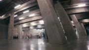 LONDON, UK - AUGUST 4, 2016:  Timelapse of tourists exploring the Tanks in the basement of the Tate Modern Gallery