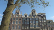 CLOSE UP: Amazing traditional buildings in canal district at sunny Amsterdam