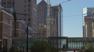 Salt Lake City Utah urban center. Business, hotels, office and apartment buildings.  Metropolitan streets. Headquarters the Church of Jesus Christ of Ladder-Day Saints or Mormons or LDS